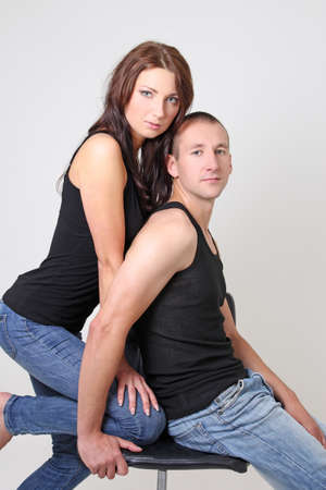 man and woman in black shirts and blue jeans Stock Photo - 15763743