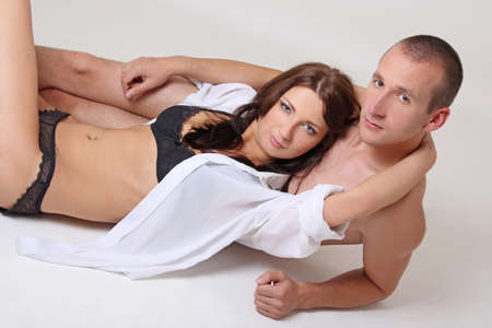 woman in lingerie and shirtless man lying