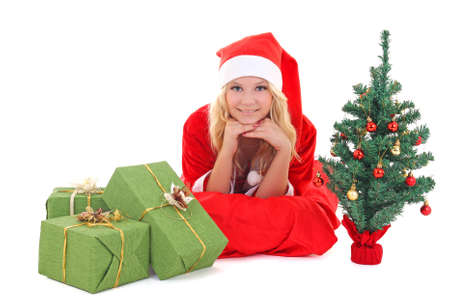 woman in santa claus costume lying with gift Stock Photo - 16011394