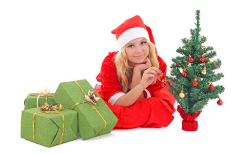 woman in santa claus costume lying with gift photo