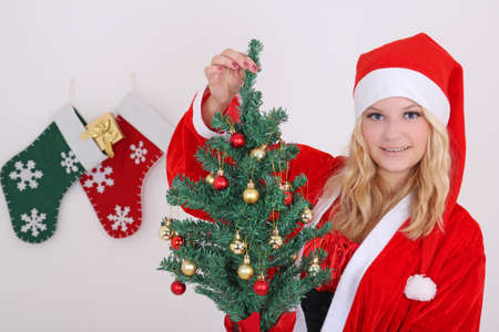 woman in santa claus costume with gift photo