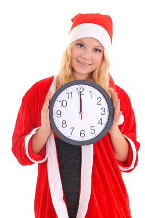 girl with santa hat holding clock isolated on white photo