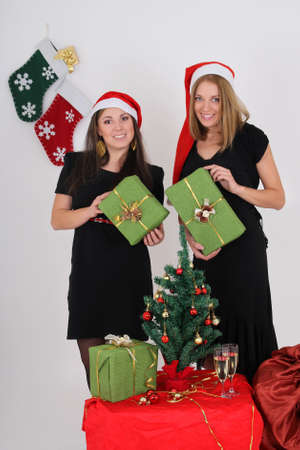 Two beautiful girls with green presents photo