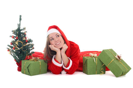 Happy dreaming santa with tree and presents over white Stock Photo - 16036676