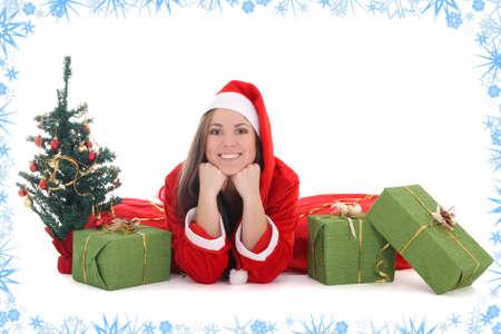 Happy santa with tree, presents and snow photo