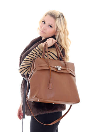 young attractive model posing with handbag over white photo