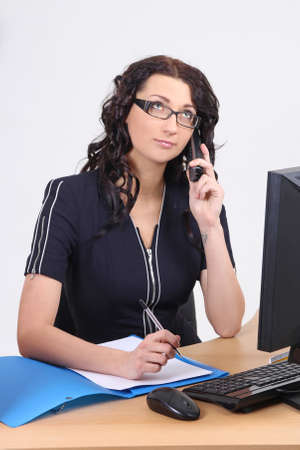 workday: Businesswoman in the office on the phone