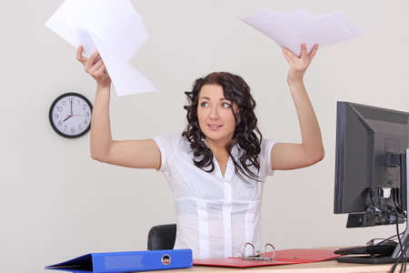 young business woman with papers flying up photo
