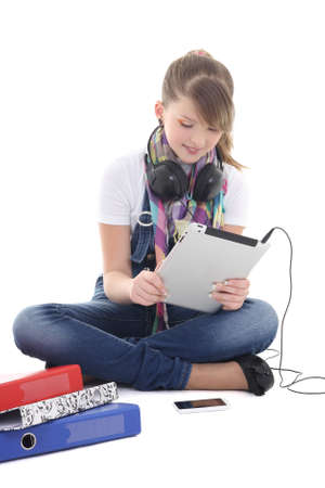 teenage girl listening music with tablet pc over white