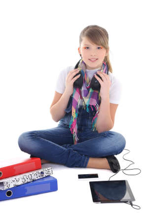beautiful teenage girl listening music with tablet pc over white photo