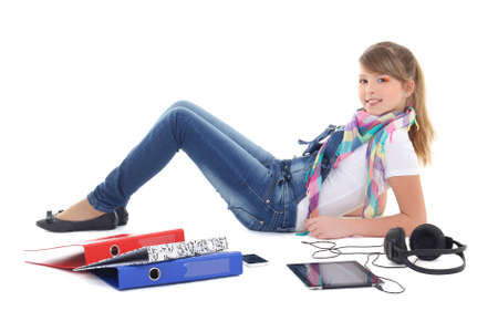 teenage girl lying and listening music with tablet pc over white