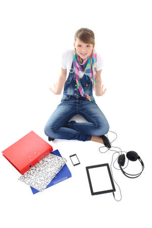 teenage girl with tablet pc, phone and headphones over white photo