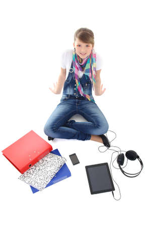 beautiful teenage girl with tablet pc, phone and headphones over white photo