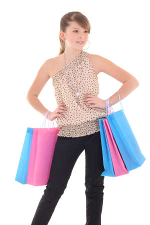 attractive teenage girl posing with shopping bags over white Stock Photo - 17593494