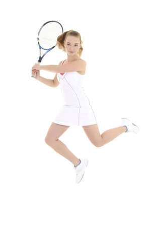 young sporty woman with tennis racket jumping over white photo