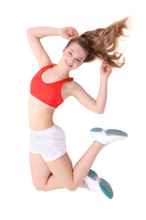 young fitness woman jumping over white background photo