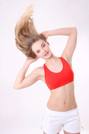 athlete woman with long blowing hair over white background photo