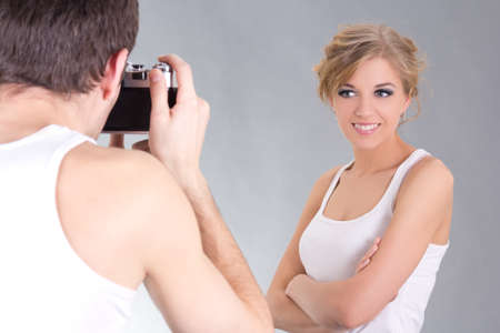 photographer and young attractive model posing photo