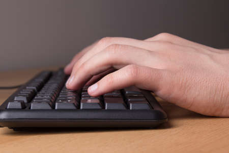typing male hands on pc keyboard photo