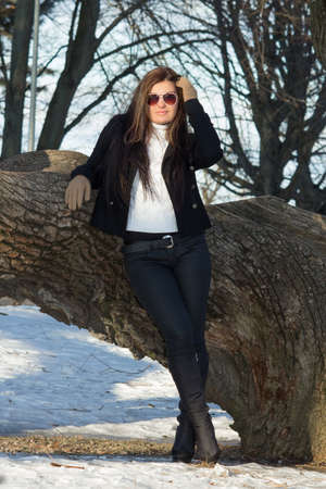 young attractive brunette in winter park photo