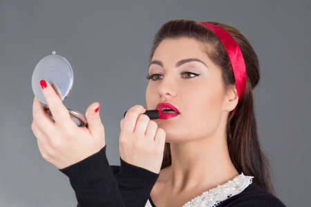 pinup girl with red lipstick and little mirror photo