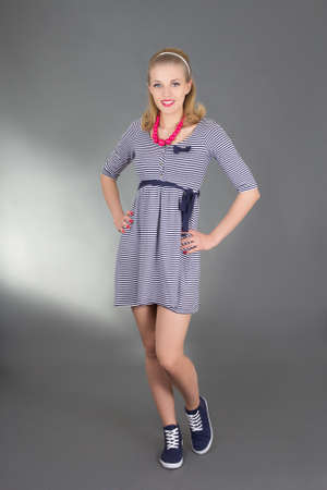 pinup girl in striped dress over grey Stock Photo - 18958384
