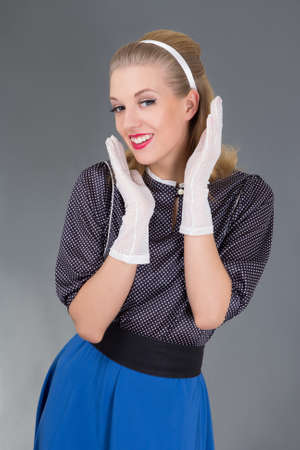 surprised girl in retro clothes over grey Stock Photo - 18958867