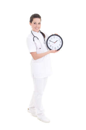 young female doctor with clock isolated on white background photo