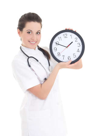 young beautiful female doctor with clock isolated on white background photo