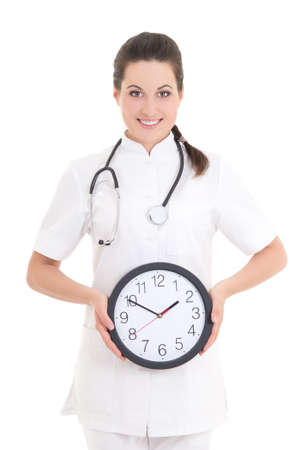 attractive female doctor with clock isolated on white background photo