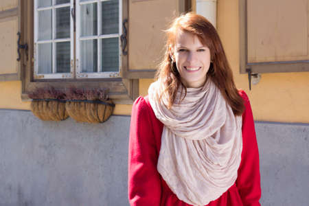 portrait of beautiful redhaired girl walking in the street photo