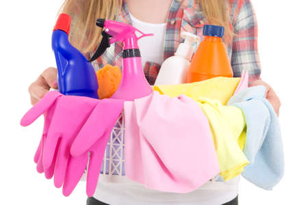 cleaning equipment in female hands over white photo
