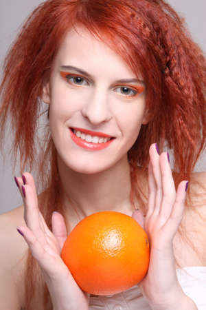 redhaired: portrait of young redhaired woman with orange