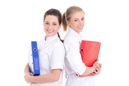 two young attractive nurses with folders over white photo
