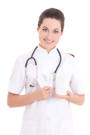 young female doctor with pills over white background photo