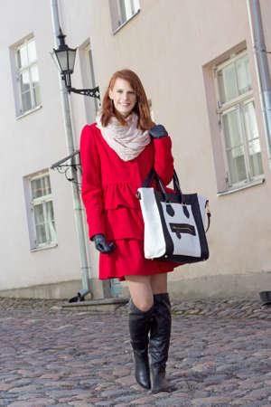 tallinn: young beautiful woman walking in  Tallinn, Estonia