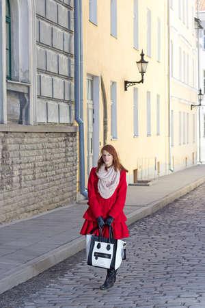 beautiful girl walking in old town of Tallinn, Estonia photo