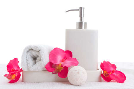 Hand soap, towel and pink orchid over white Stock Photo