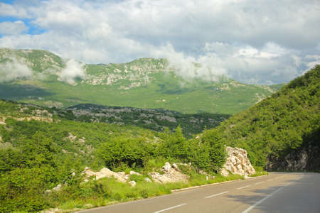 view of the mountains and road in Montenegro photo