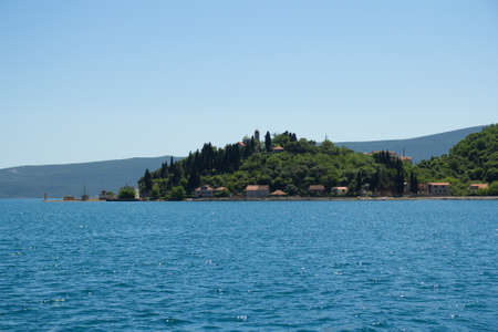 little green island with old buildings in Montenegro photo