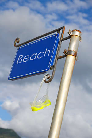 metal signboard with diving mask on the beach photo