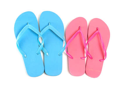 male and female flip flops over white background photo