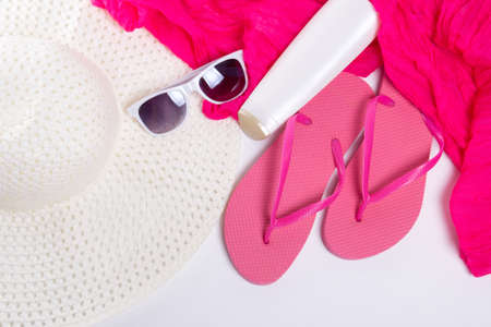 pink shoes: flip flops, hat, sunglasses and cream over white Stock Photo