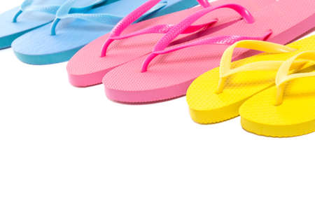 colorful summer flip flop shoes over white background photo