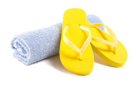 flip: yellow flip flop shoes and towel isolated on white background