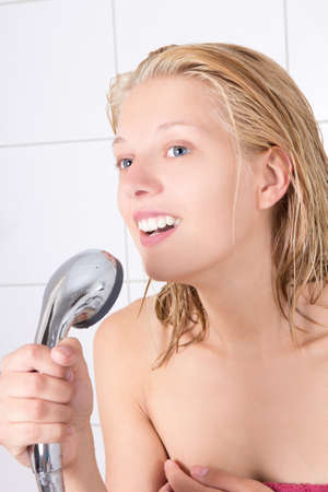 douche: young funny beautiful girl singing in shower