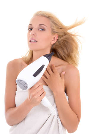 young attractive woman drying her hair with hairdryer photo