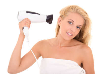 beautiful girl with hairdryer isolated on white background photo