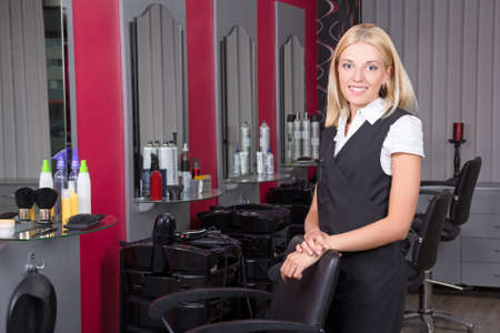 professional female hairdresser in beauty salon photo