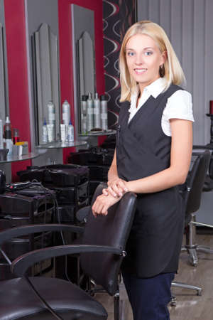 portrait of professional female hairdresser in beauty salon